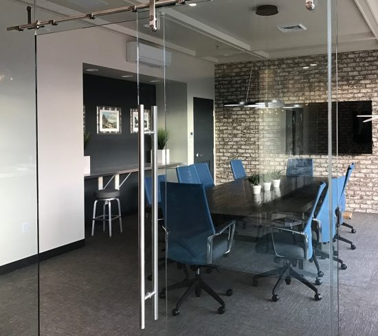 Clear glass walls provide separation for privacy while creating the idea of easy access to a meeting space.