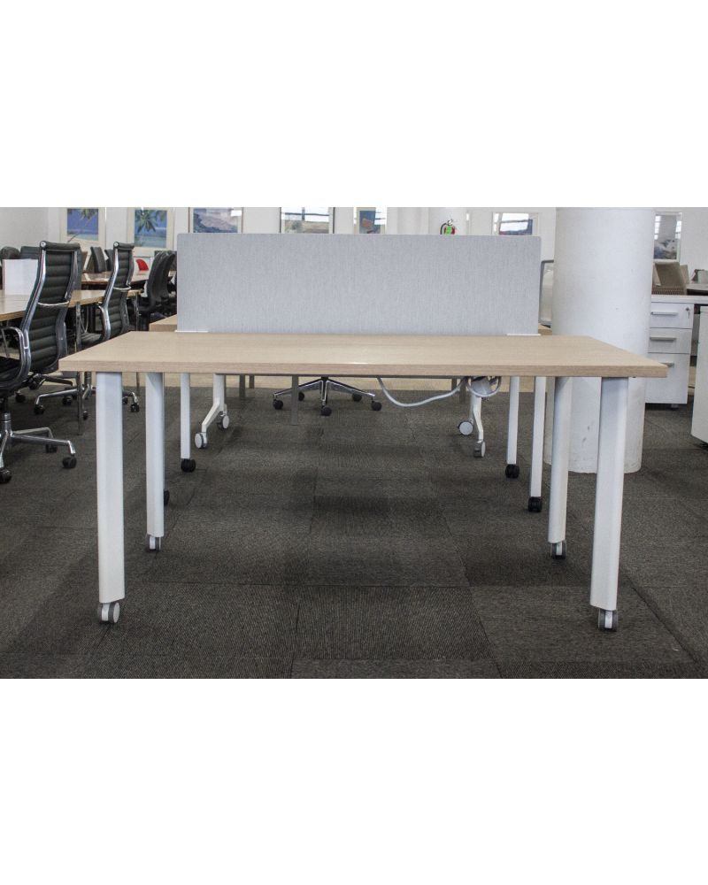 """Pre-owned table desk has walnut laminate surface and a oatmeal modesty panel. Rests upon (4) white metal rectangular castered post legs. With power. Dimensions: 30""""D x 60""""W."""