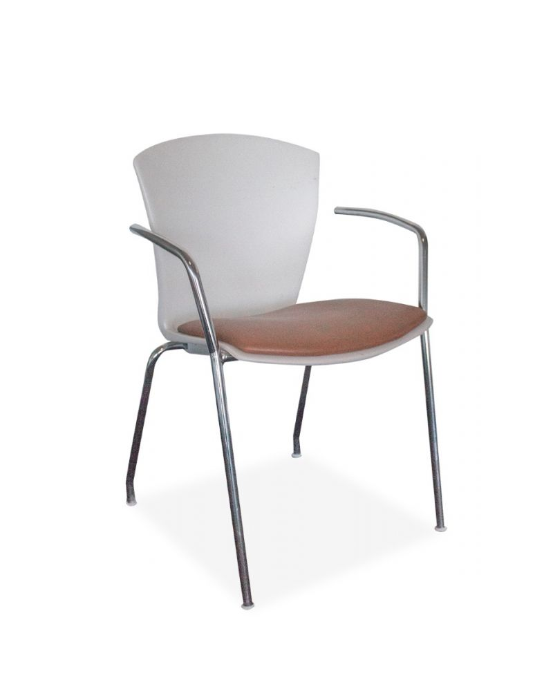 Pre-owned Thone stack chair has white plastic body with peach vinyl seat.