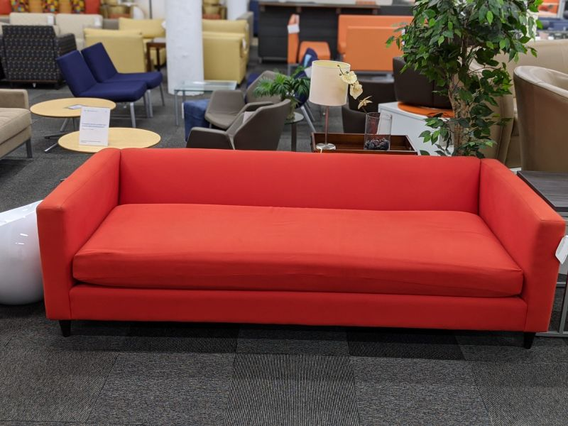 CB2 sofa has red fabric upholstery
