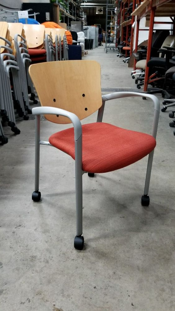 Pre-owned Haworth Improv mobile side chair has maple back and red striped patterned seat.