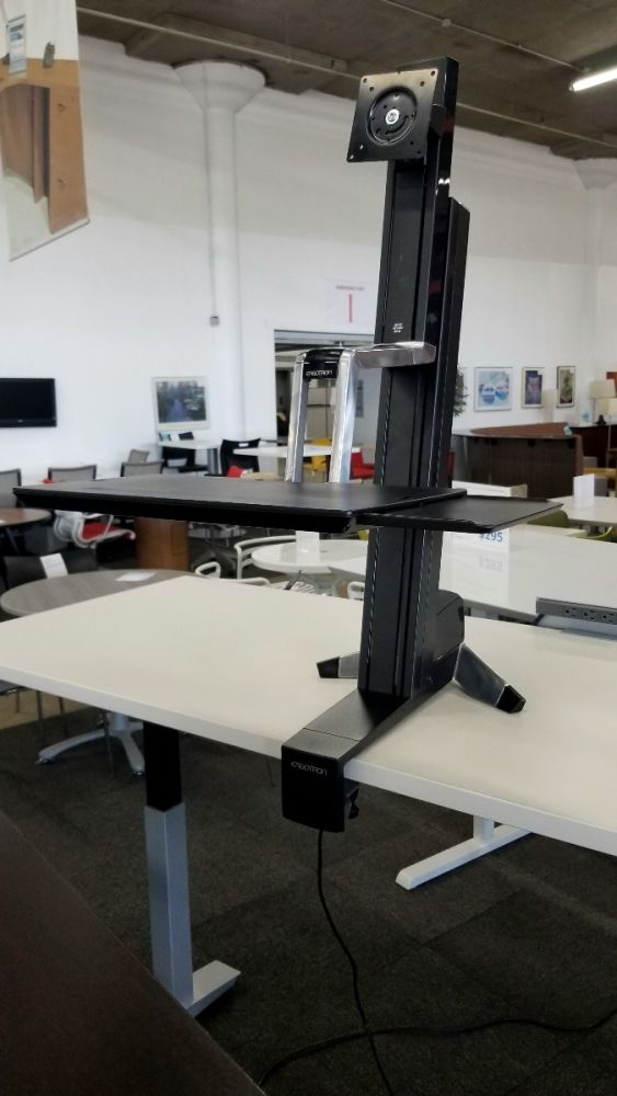 Pre-owned Ergotron WorkFit single monitor workstation mounts to the front of a work surface.