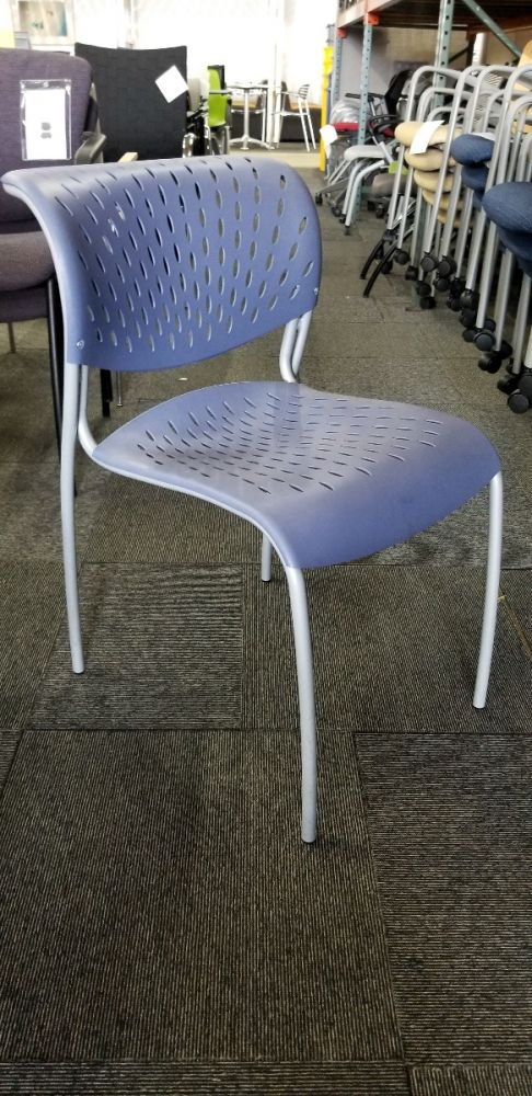 Pre-owned Izzy Hannah stack chair has Blueberry thermoplastic seat and back with (4) Silver post legs.