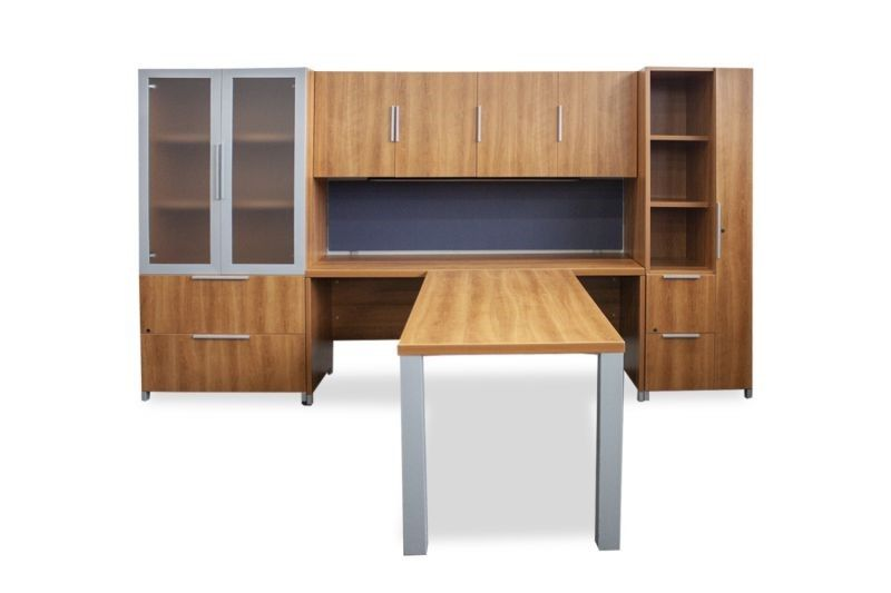 """Pre-owned Lacasse T-shaped private office has cherry laminate finish. Desk is reversible and set has right-handed wardrobe tower. Components: - Desk (30""""D x 59""""W x 31""""H) with metallic silver post legs - Return (24""""D x 71""""W x 31""""H) - Overhead storage ("""