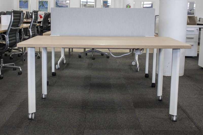 "Pre-owned table desk has walnut laminate surface and a oatmeal modesty panel. Rests upon (4) white metal rectangular castered post legs. With power. Dimensions: 30""D x 60""W."