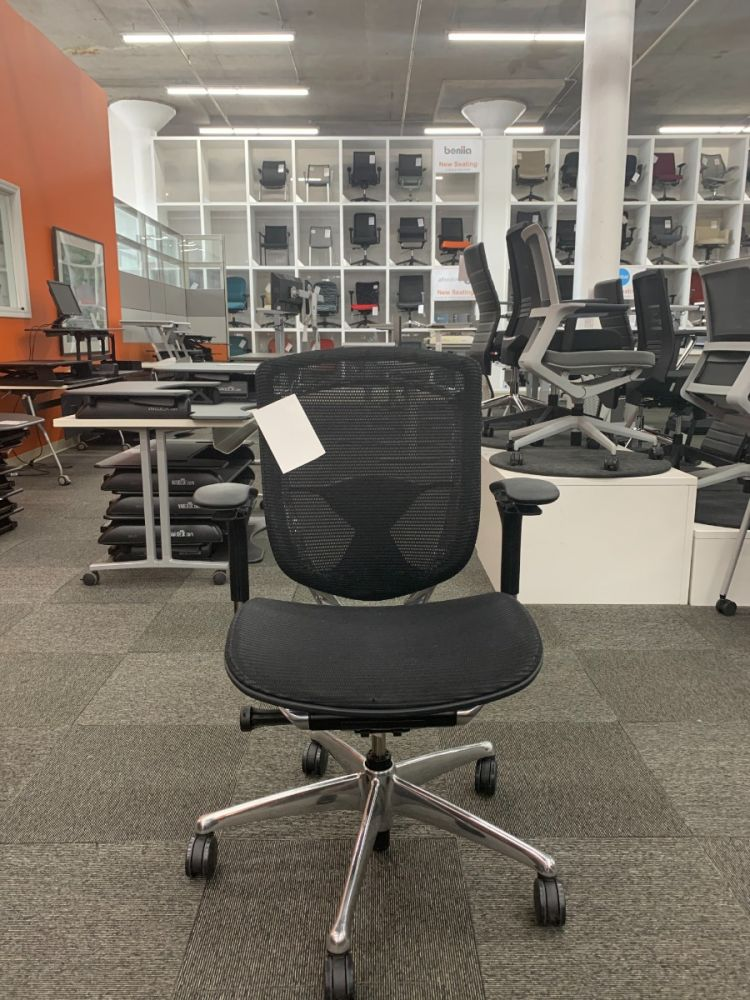 Pre-owned Teknion Contessa task chair has black mesh body, black adjustable height arms, and a chrome frame with five-star castered base. -B GRADE-
