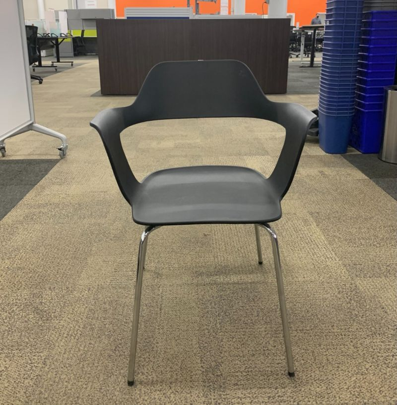 Front view of New OfficeSource Zella Collection stack chair has black body with cutout back and (4) chrome post legs. -A GRADE-