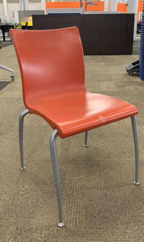 Pre-owned Vecta Weisner Hager has orange body and (4) metallic silver post legs. Armless. -B GRADE