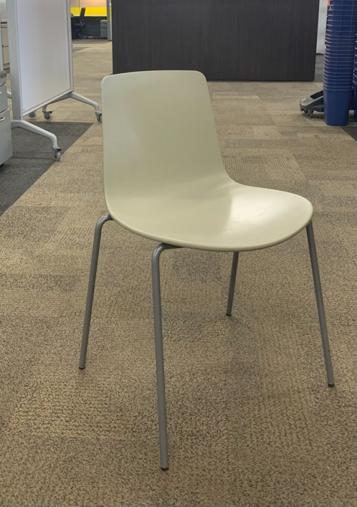 Front view of Pre-owned Steelcase Coalesse Ena Lottus side chair has light cream body and (4) metallic silver post legs. -A GRADE-