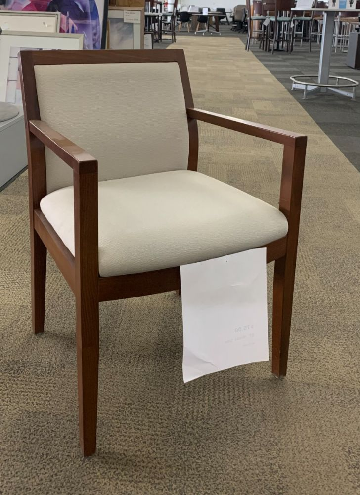 Angle view of Pre-owned Global wood side chair has light tan upholstered seat and back, with a cherry frame with (4) post legs. -A GRADE-