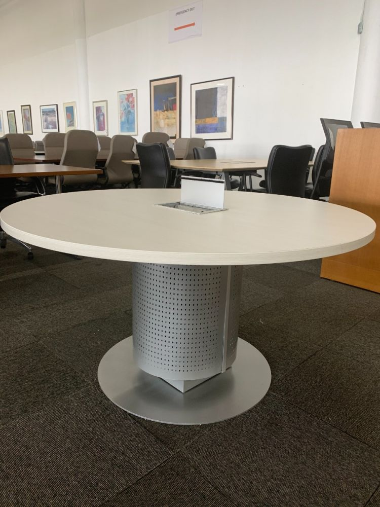 "Full view of Pre-owned Knoll Propeller round teaming table has light mocha laminate surface with a metallic silver disc base with perforated body. Dimensions: 54"" in diameter. -A GRADE-"