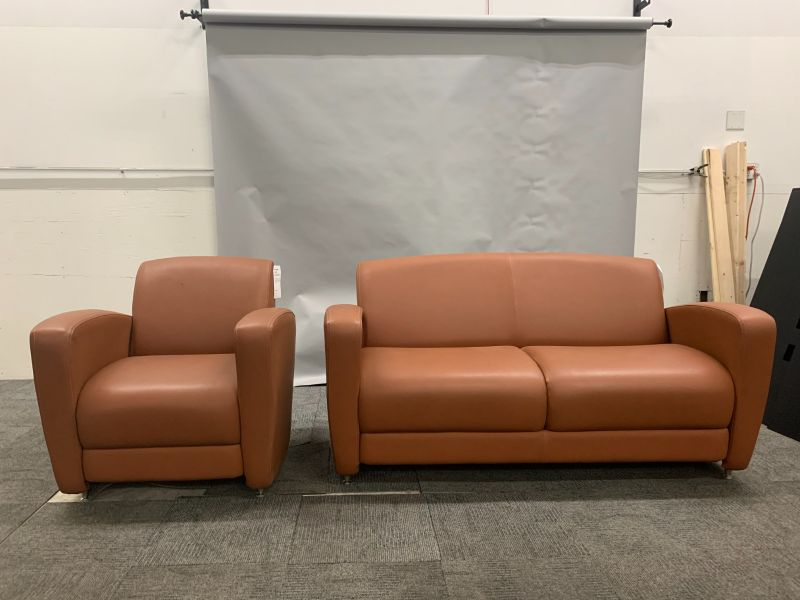 (1) lounge chair and (1) loveseat, each with brown leatherette upholstery and (4) chrome feet.