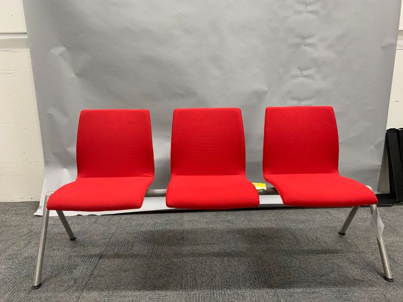 (3) armless seats with red upholstered bodies and a metallic silver frame with (2) A-legs