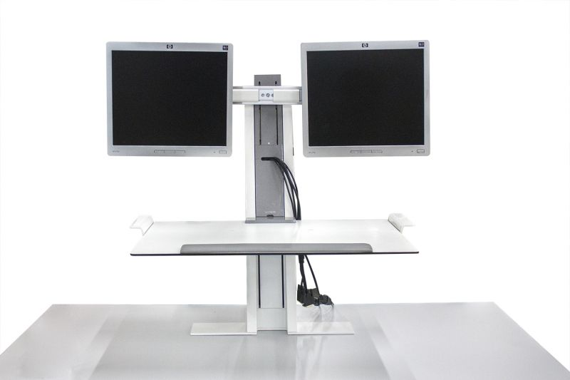 Pre-owned Humanscale workstation unit has white finish and dual-monitor arms.