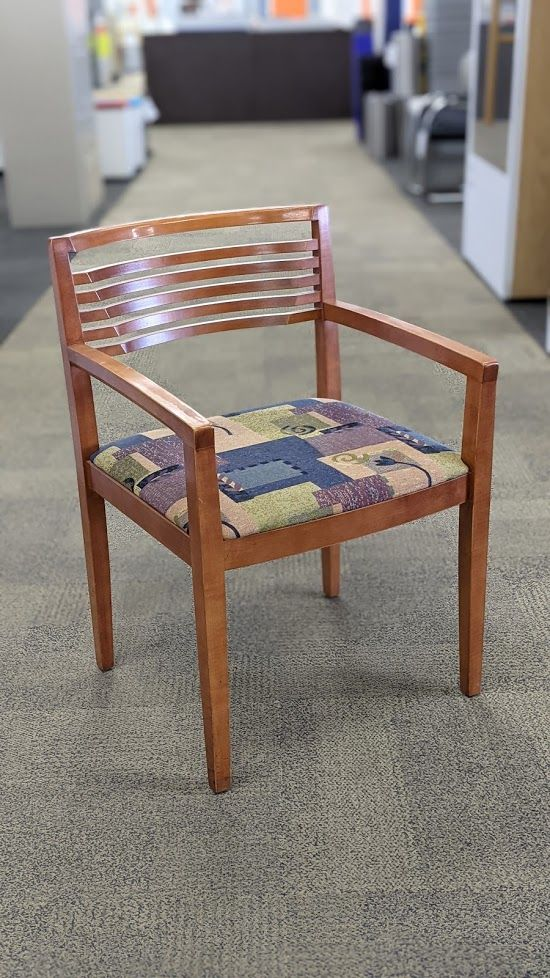Front view of Pre-owned Knoll Ricchio wood side chair with large blue violet squares.
