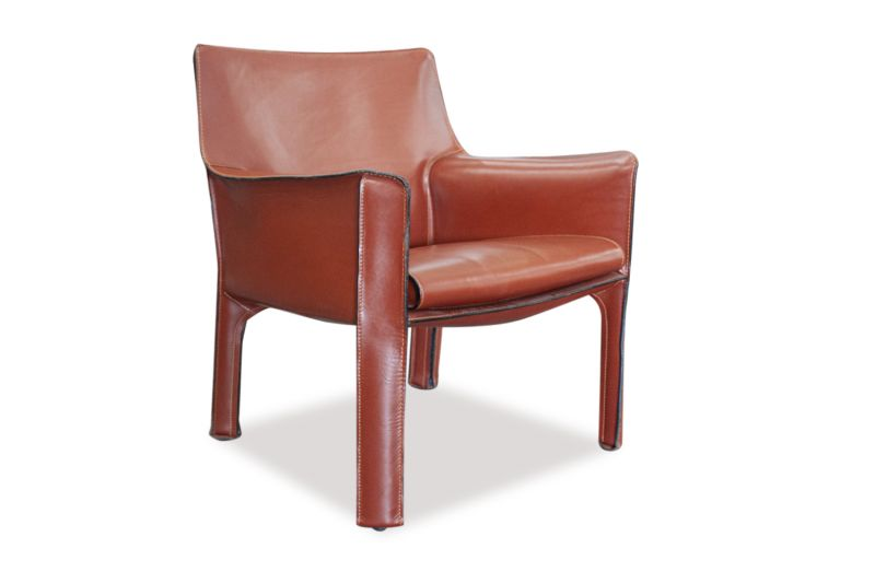 Pre-owned Cassina CAB lounge chair has orange leather body, arms and legs.