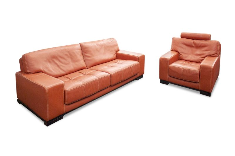 "Pre-owned Roche Bobois lounge set features (1) sofa (40""D x 94""W) and (1) lounge chair with pale red leather upholstery and black wood bases."