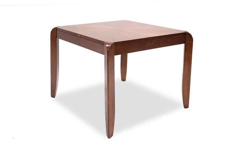 Pre-owned side table has quartered mahogany veneer surface. With (4) post legs on corners of table.