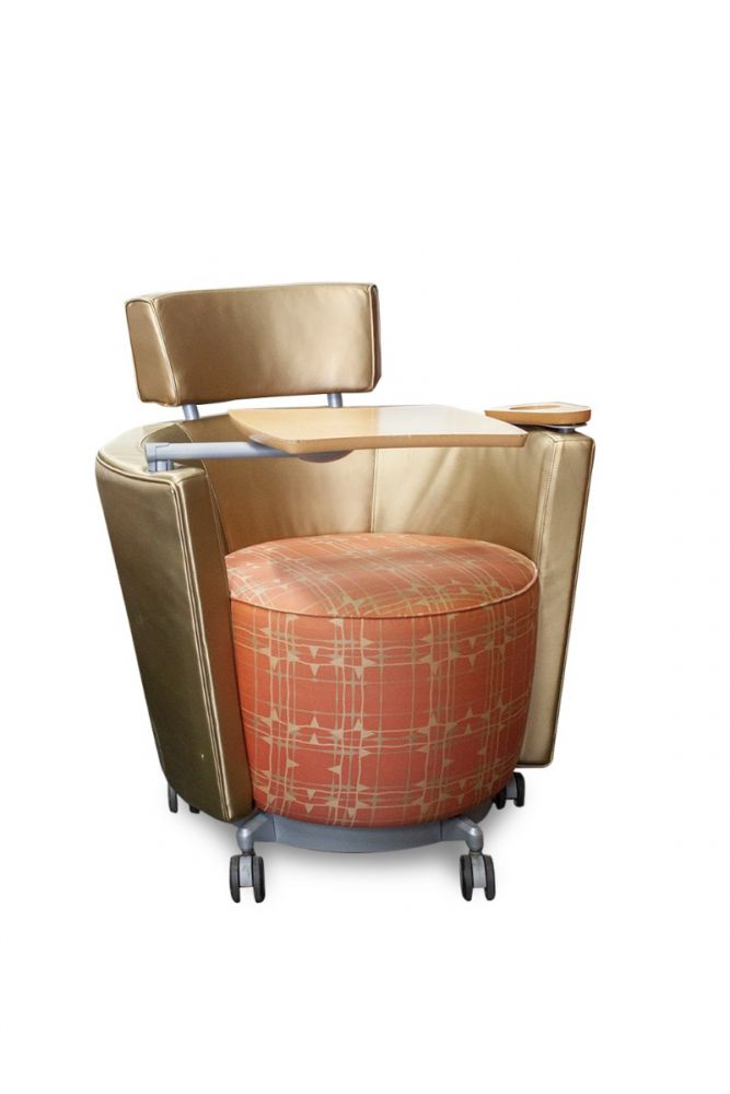 Pre-owned Haworth Hello mobile lounge chair has gold vinyl upholstered back/body an orange square patterned fabric seat/front. Metallic silver base with (5) casters. Features non-handed tablet arm and cup holder.