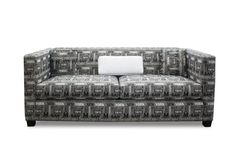 Reupholstered loveseat has grey and white upholstery with Shanghai, Tokyo, Milan, Paris, London and New York print patterns.