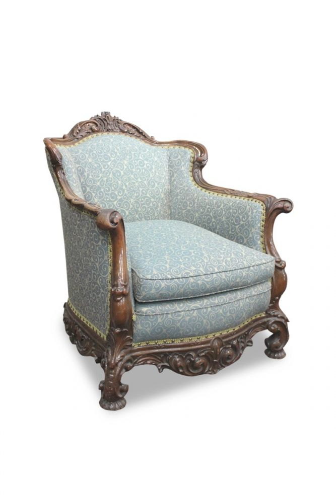 Pre-owned Rococo-style armchair has carved walnut frame, emerald curlicue-patterned upholstery and gold-lace-and-bead trim.