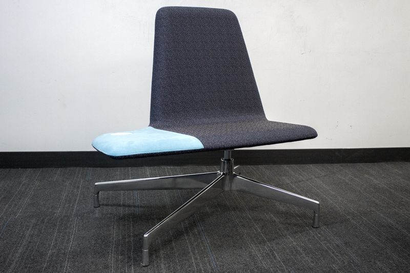 Pre-owned Haworth Harbor Work lounge chair has purple brick patterned upholstery with a chrome X-base.
