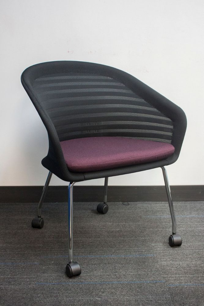 Pre-owned Allermuir Mayze lounge chair has a black mesh back and a dark violet seat.