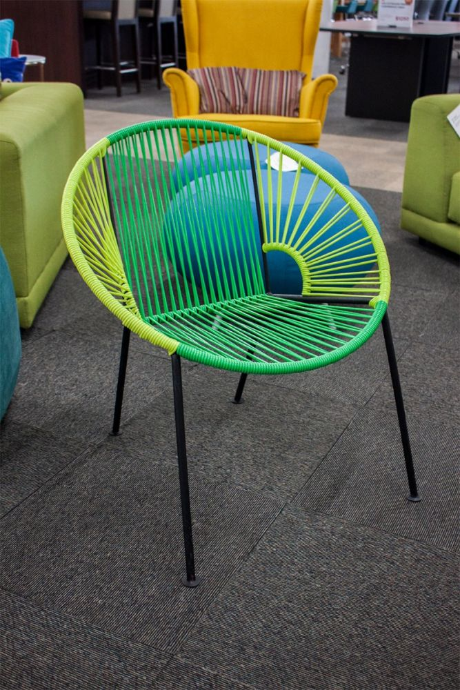 Pre-owned basket side chair features plastic straps woven to a black frame with (4) post leg. Green straps for seat and back; light green straps for arms.