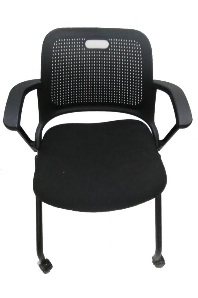 Pre-owned Allsteel Get Set nesting chair has a black perforated seat back and black upholstery with jagged line patterns.