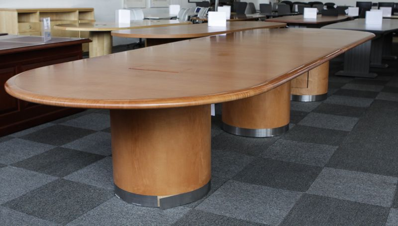 Pre-owned racetrack conference table has two-piece maple veneer top with (3) comparmented drum bases with metal trim and (2) data/power points.
