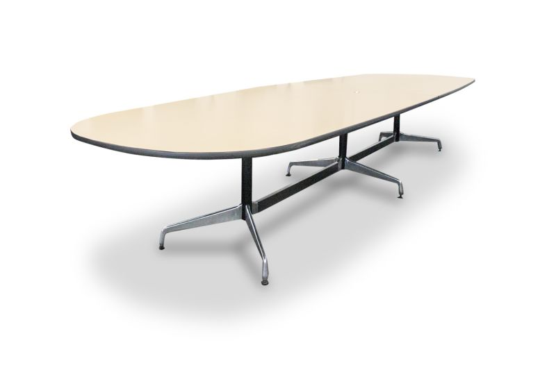 Pre-owned Herman Miller racetrack conference table has maple veneer surface with black edge banding.