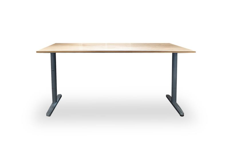 "Pre-owned Ikea Bekant table desk has a maple laminate surface. With (2) metallic silver T-legs. Dimensions: 32""D x 63""W."