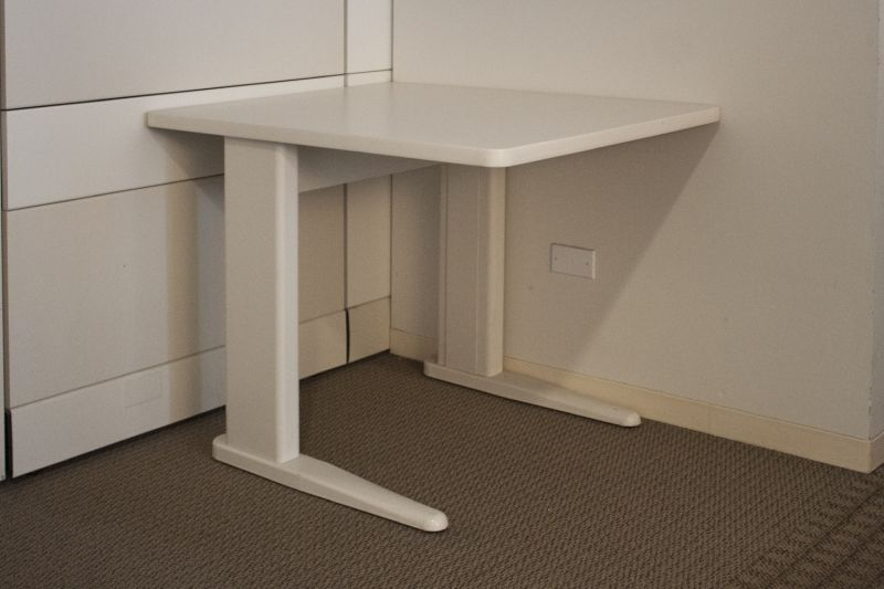 Pre-owned training table has white laminate surface and white metal L-legs.