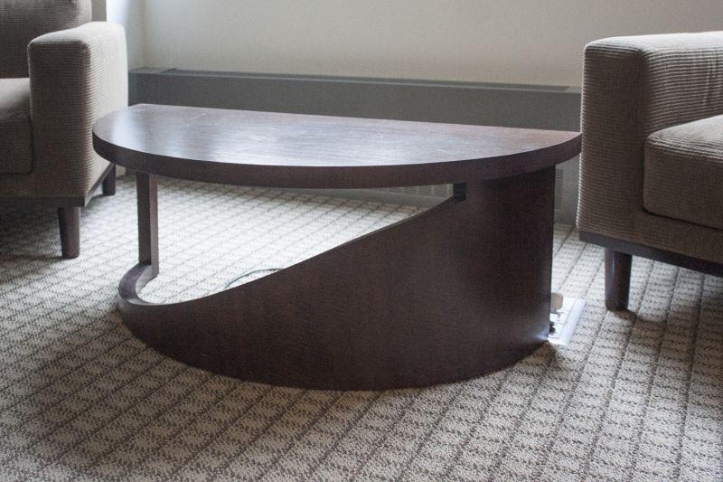 Pre-owned modern half-moon side table has walnut veneer finish.